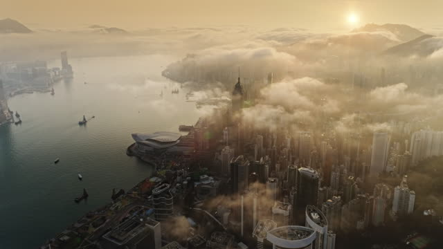 hong kong from air at sun rise - air pollution stock videos & royalty-free footage