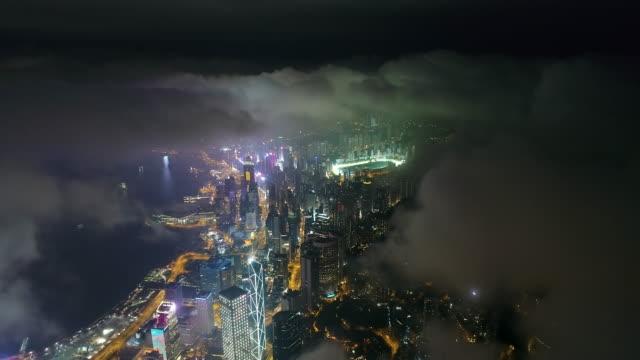 hong kong from over the clouds at night - hong kong stock videos & royalty-free footage