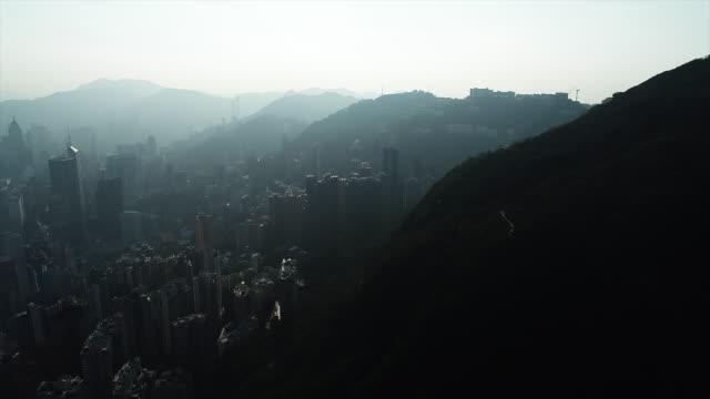 hong kong harbour skyline sunrise - hong kong island stock videos & royalty-free footage
