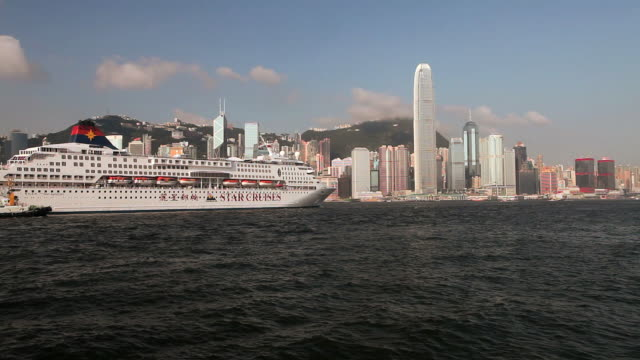 hong kong harbour with large cruise ship accompanied by tug - westernisation stock videos & royalty-free footage