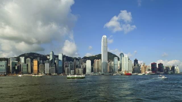 hong kong, high angle from victoria peak, mount austin,, hong kong island across harbour to kowloon. - bank of china tornet hongkong bildbanksvideor och videomaterial från bakom kulisserna