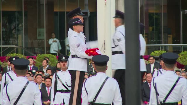 hong kong holds a flag raising ceremony to mark the 65th anniversary of the founding of communist china with a heavy police presence as protesters... - hong kong flag stock videos & royalty-free footage