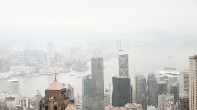 hong kong, hong kong island, skyscrapers of central district - berg victoria peak stock-videos und b-roll-filmmaterial