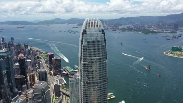 hong kong iconic skyscraper city crowded highrise harbour panorama china - victoria harbour hong kong stock videos & royalty-free footage