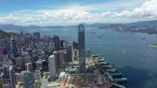 hong kong iconic skyscraper city crowded highrise harbour panorama china - central district hong kong stock videos & royalty-free footage