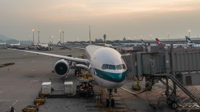 t/l ws zo hong kong international airport day to night transition / hong kong, china - hong kong international airport stock videos and b-roll footage