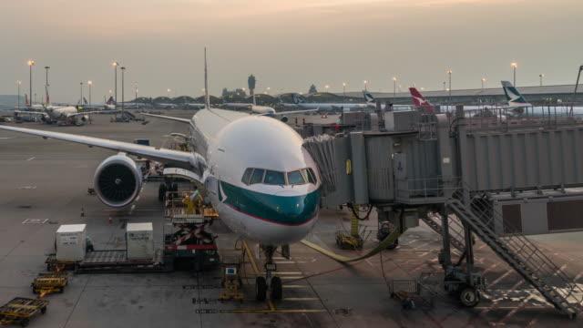 t/l ws pan hong kong international airport day to night transition / hong kong, china - hong kong international airport stock videos and b-roll footage