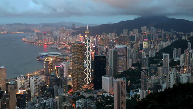 hong kong island at dusk, high angle view from victoria peak, mount austin,, locked off - bank of china tower hong kong stock videos and b-roll footage