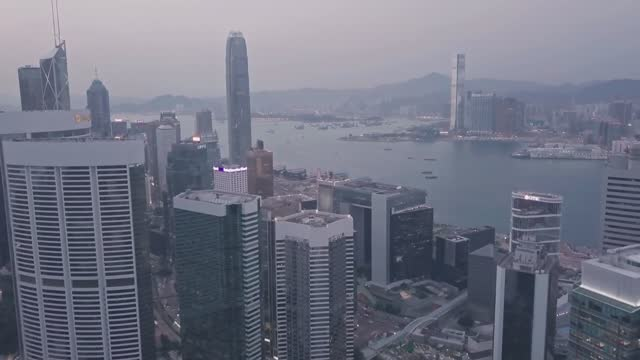 stockvideo's en b-roll-footage met hong kong island downtown city centre skyline at night. aerial drone view - hong kong
