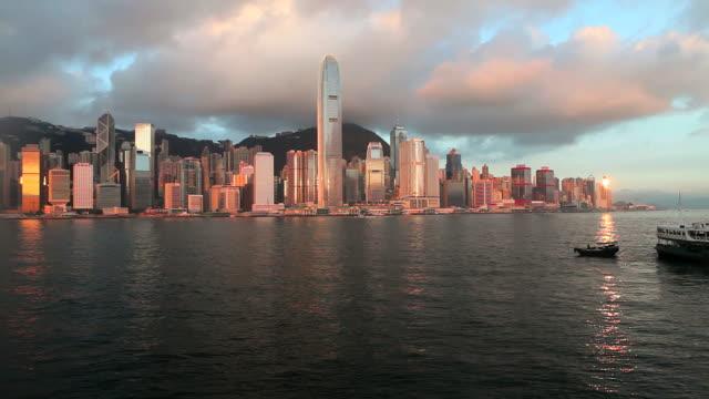 hong kong island skyline and harbour from tsim sha tsui, kowloon, pan right to left - bank of china tornet hongkong bildbanksvideor och videomaterial från bakom kulisserna