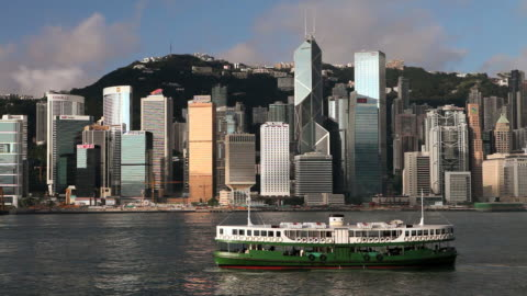hong kong island skyline, high rises admiralty and central, harbour, star ferry, locked off - star ferry stock-videos und b-roll-filmmaterial