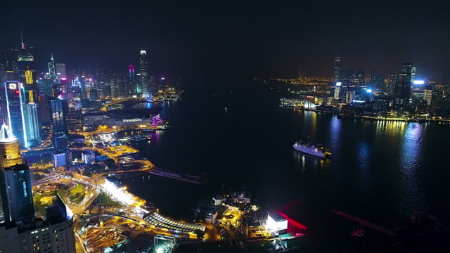 hong kong island victoria harbour and kowloon aerial - cityscape stock videos & royalty-free footage
