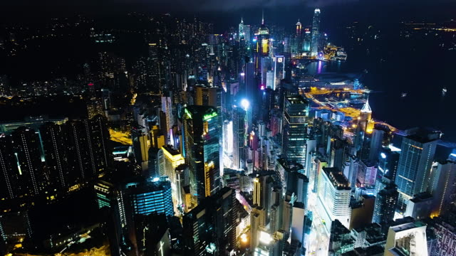 hong kong island victoria harbour and kowloon aerial - night stock videos & royalty-free footage