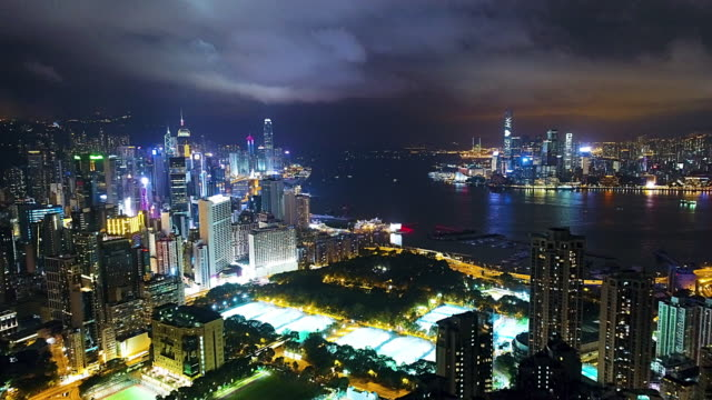 hong kong island victoria harbour and kowloon aerial - victoria harbour hong kong stock videos & royalty-free footage