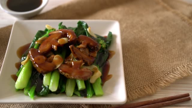 hong kong kale stir fried in oyster sauce - cabbage stock videos and b-roll footage