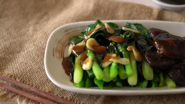hong kong kale stir fried in oyster sauce - saute stock videos and b-roll footage