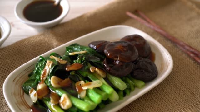 hong kong kale stir fried in oyster sauce - mixing stock videos and b-roll footage