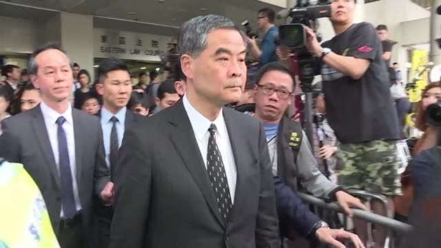 Hong Kong leader Leung Chun ying leaves court after his second day testifying in an assault case against a legislator who threw a glass at him in...