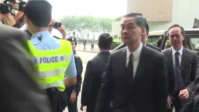 Hong Kong leader Leung Chun ying returns to court to testify in an assault case against a legislator who threw a glass at him in parliament