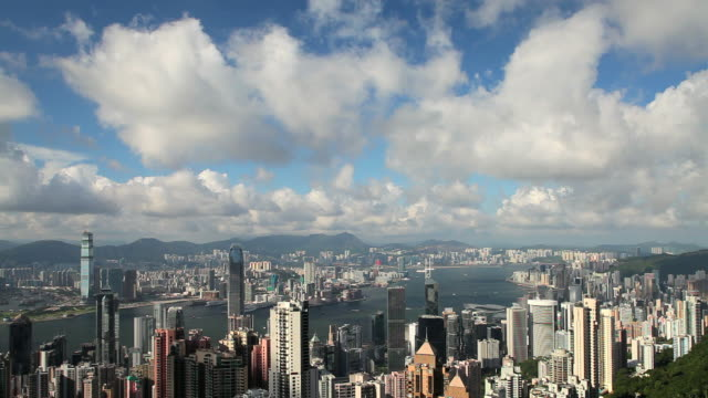 t/l hong kong lighting up, dusk to night, high angle view from victoria peak, mount austin,, hong kong island across the harbour to kowloon. - bank of china tower hong kong stock videos and b-roll footage