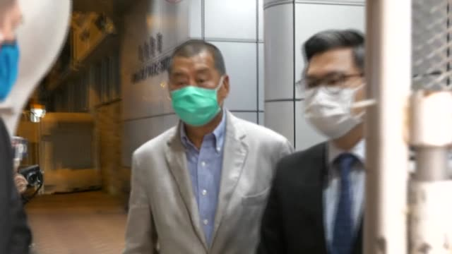 hong kong media tycoon jimmy lai is released from police custody over a day after being detained under a sweeping security law imposed by china - composizione di fiori video stock e b–roll