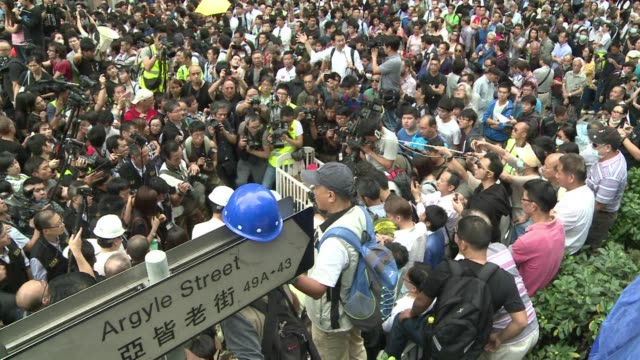 hong kong police arrest at least 10 people as scuffles break out when demonstrators try to block authorities from clearing part of a pro democracy... - occupy central stock videos & royalty-free footage