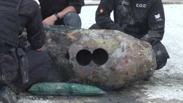 hong kong police experts pose with a 450 kilogramme usmade world war ii bomb after unearthing and defusing the ordnance in the city's wanchai... - wanchai stock videos and b-roll footage