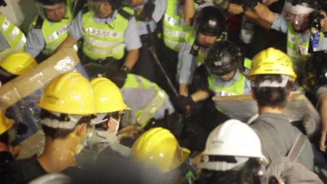 hong kong police say they had no other choice after unleashing pepper spray and baton charges at students who tried to storm government headquarters... - occupy central stock videos & royalty-free footage
