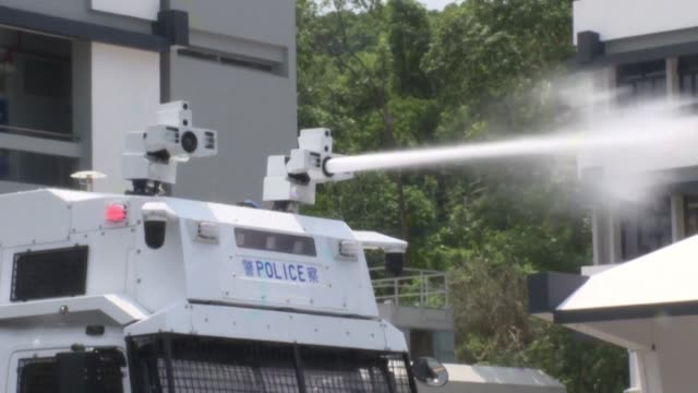 hong kong police unveil water cannon trucks as a new way to combat pro democracy protesters after tear gas and rubber bullets failed to stop more... - water cannon stock videos and b-roll footage