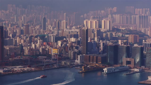 hong kong port. boats arriving. view from the peak - spoonfilm stock-videos und b-roll-filmmaterial