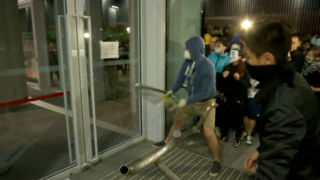 prodemocracy movement allegedly infiltrated by triad gang t18111411 / tx various shots protesters smashing windows of hong kong's legislative council... - 2014 stock videos and b-roll footage