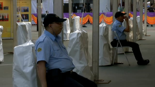 pro-democracy protesters threaten to occupy more government buildings; security guards sitting chinese histiory display sign man along past chinese... - hong kong flag stock videos & royalty-free footage