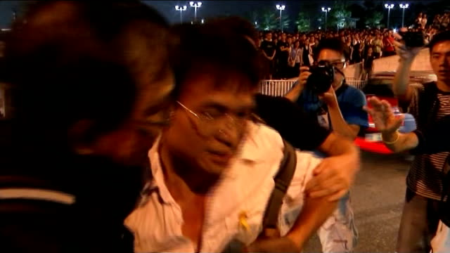 leader cy leung offers talks but refuses to resign china hong kong prodemocracy campaigners running past barriers in road man being held back by... - protestor stock videos & royalty-free footage