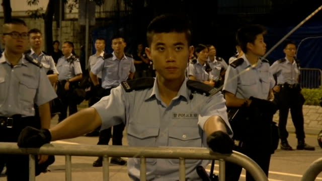Leader CY Leung offers talks but refuses to resign CHINA Hong Kong Pro Democracy protesters sat in road Various shots metal barriers with police...