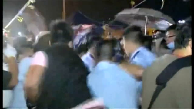 rising tensions over continued prodemocracy demonstrations protester holding placard with ken tsang photographs showing bruises dennis kwok talking... - protestor stock videos & royalty-free footage