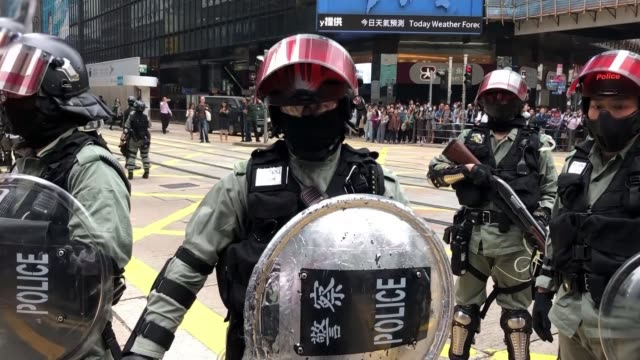 students' standoff with police continues hong riot police approaching camera and shouting to get on pavement close shot riot police closing in on... - filming stock videos & royalty-free footage