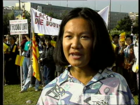 Hong Kong refugees conference a Geneva AV Flag flying from on top building PULL OUT Vietnamese boat people demos standing in BV with banners CMS...