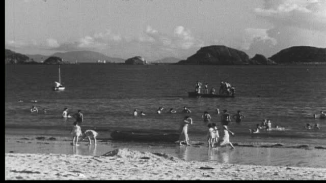 vídeos de stock e filmes b-roll de 1938 hong kong - repulse bay beach - 1930