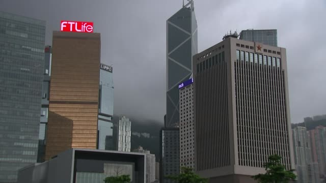 rotation of chinese troops used to intimidate protesters china hong kong various of skyscrapers with low clouds around int reporter sat in office... - mok stock videos and b-roll footage