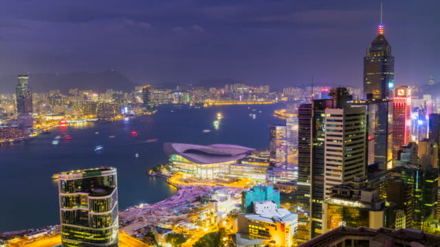 hong kong skyline and harbour by night, time lapse - hong kong island stock videos & royalty-free footage