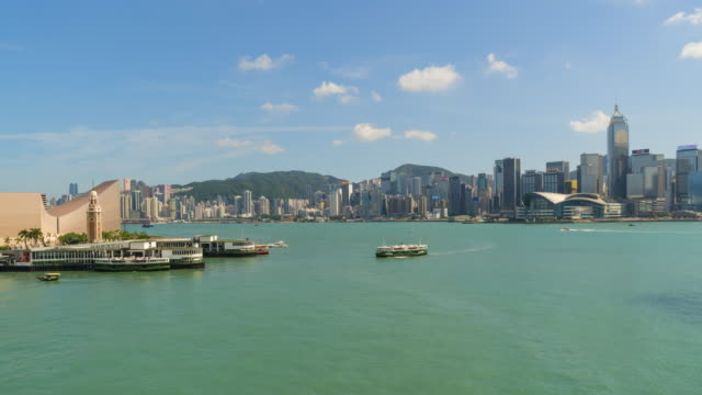 hong kong skyline and star ferry pier time lapse - hong kong island stock videos & royalty-free footage