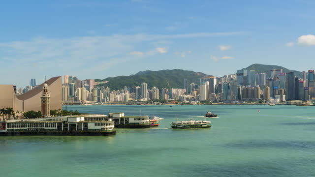hong kong skyline and star ferry pier time lapse - tsim sha tsui stock videos & royalty-free footage