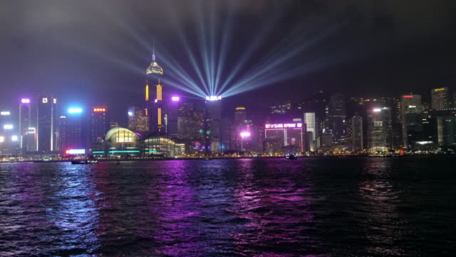 hong kong skyline at night from avenue of the stars - orchestra stock videos & royalty-free footage