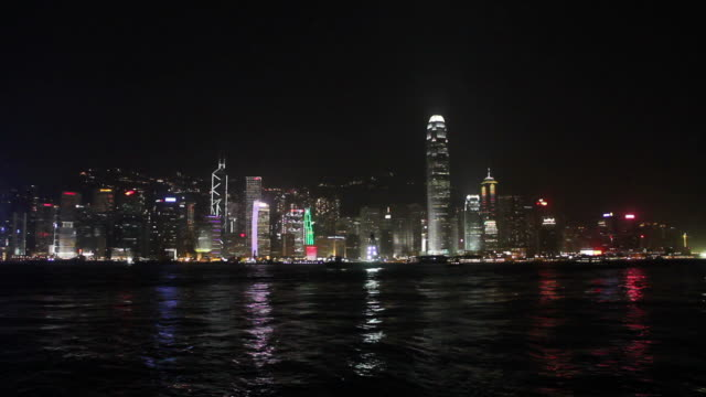 hong kong skyline at night. - victoria harbour hong kong stock videos and b-roll footage
