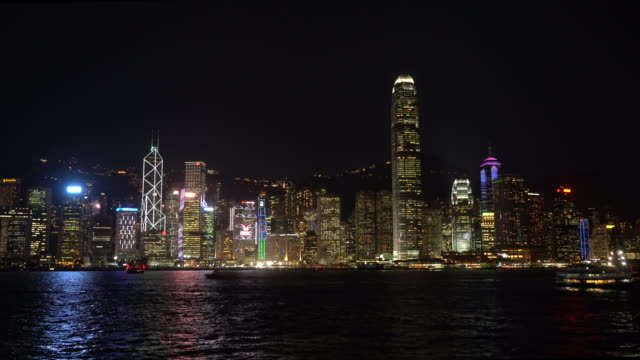 hong kong skyline by night - victoria harbour hong kong stock videos and b-roll footage