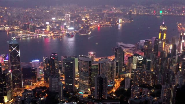 hong kong skyline cityscape by night - inquadratura da un aereo video stock e b–roll