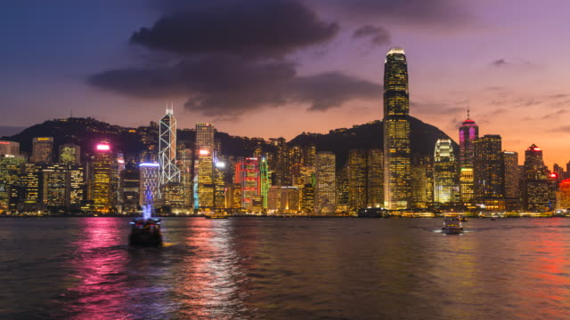 hong kong skyline, day to night time lapse - hong kong island stock videos & royalty-free footage