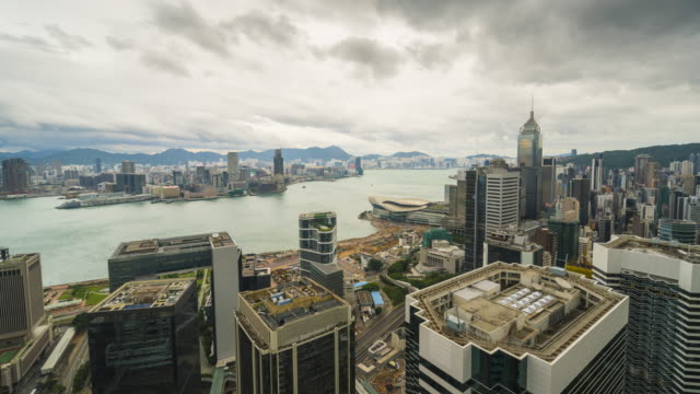 hong kong skyline during stormy weather, time lapse. - central plaza hong kong stock videos & royalty-free footage