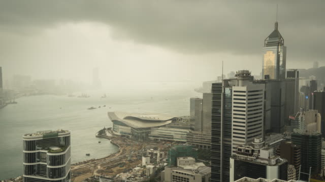 hong kong skyline during stormy weather, time lapse. - wanchai stock videos and b-roll footage