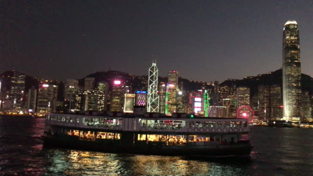 stockvideo's en b-roll-footage met hong kong star ferry bij dusk victoria harbour - star ferry